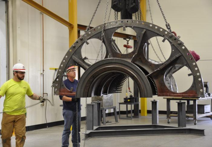 UBC millwrights install turbine component