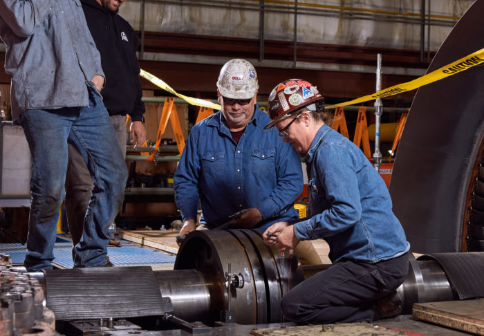 UBC millwrights installing industrial component