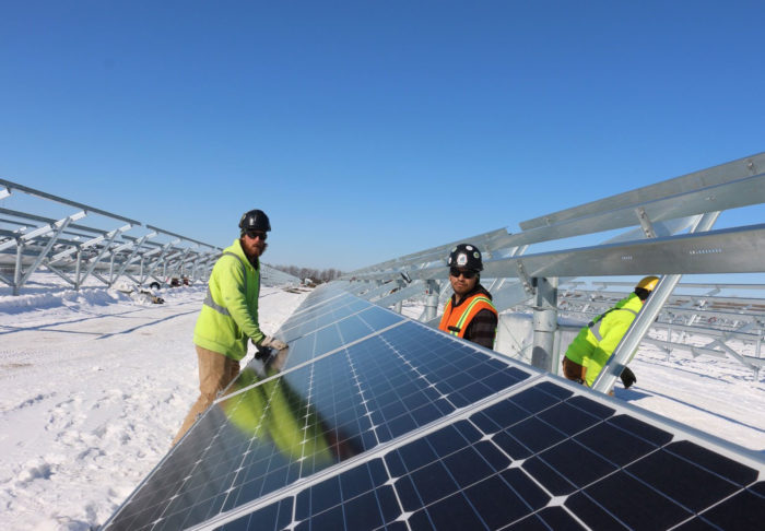 UBC millwrights working on solar panels