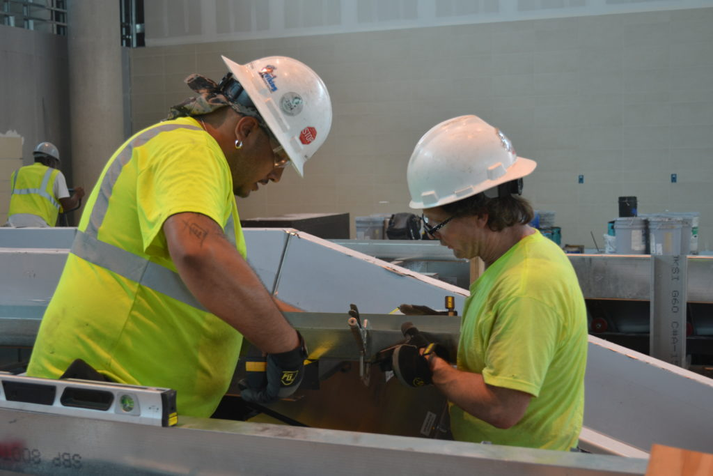 UBC millwrights using metal clamps
