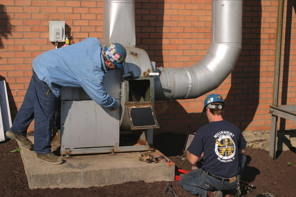 UBC millwrights fixing an industrial blower