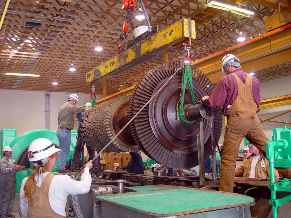 UBC millwrights lifting a heavy turbine