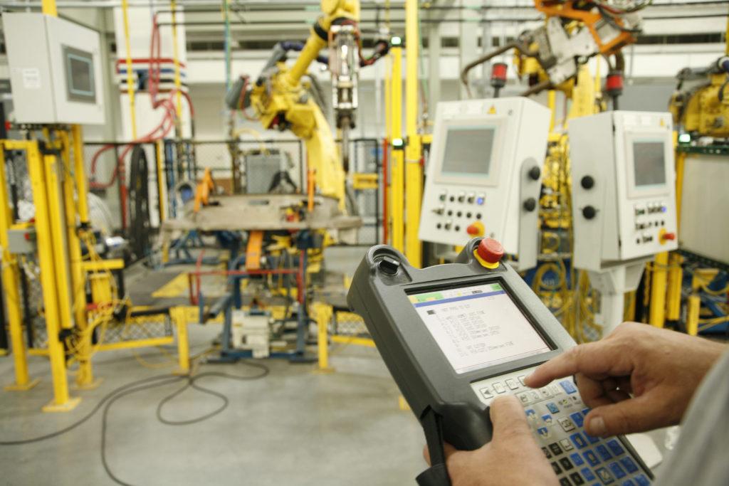 UBC millwright calibrating industrial equipment