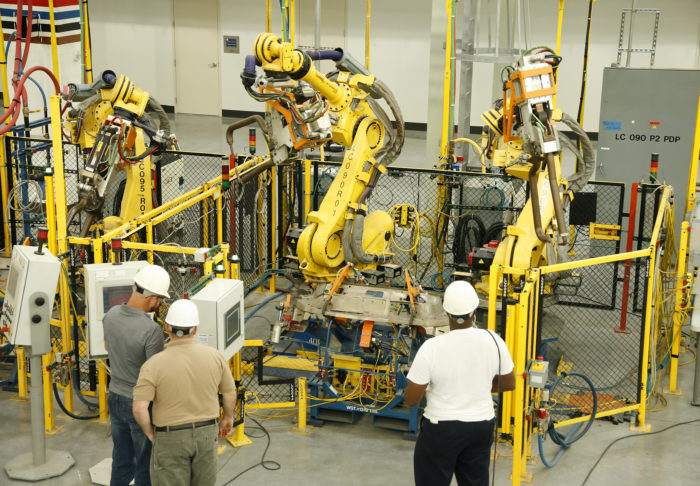 UBC millwrights inspecting industrial robots