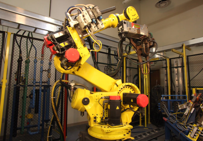 Industrial robot that UBC millwrights install