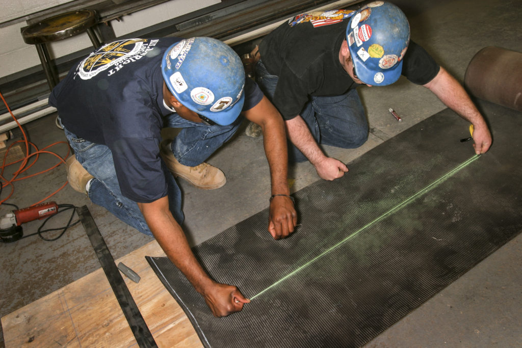 UBC millwrights using a chalk line