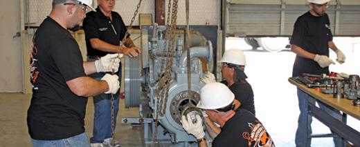 UBC millwrights move a turbine
