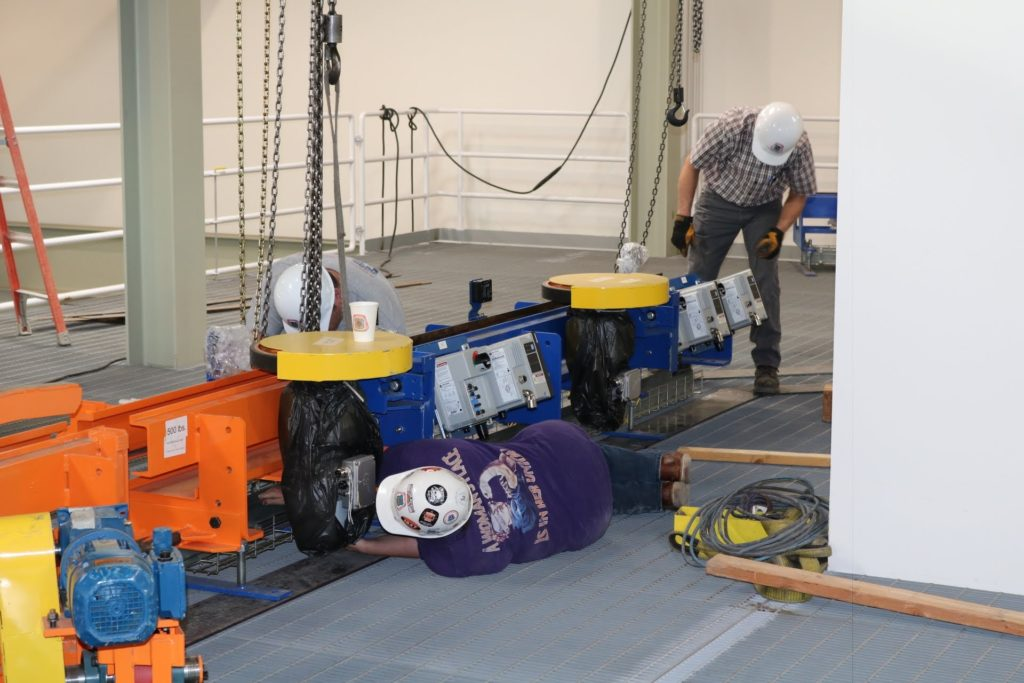 UBC millwrights doing equipment installation